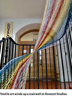 A piece of textile art twists up a stairwell at Dovecot Studios.