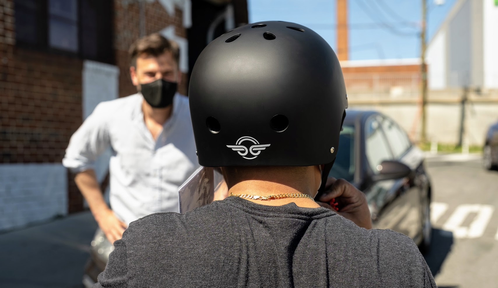 Person wearing helmet with Bird sticker on back