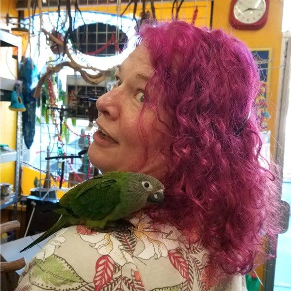 catherine tobsing with dusky conure on shoulder