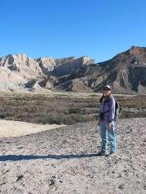 Lynn standing in desert
