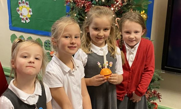 Celebrating Christingles in The Year 1/2 Ladybirds