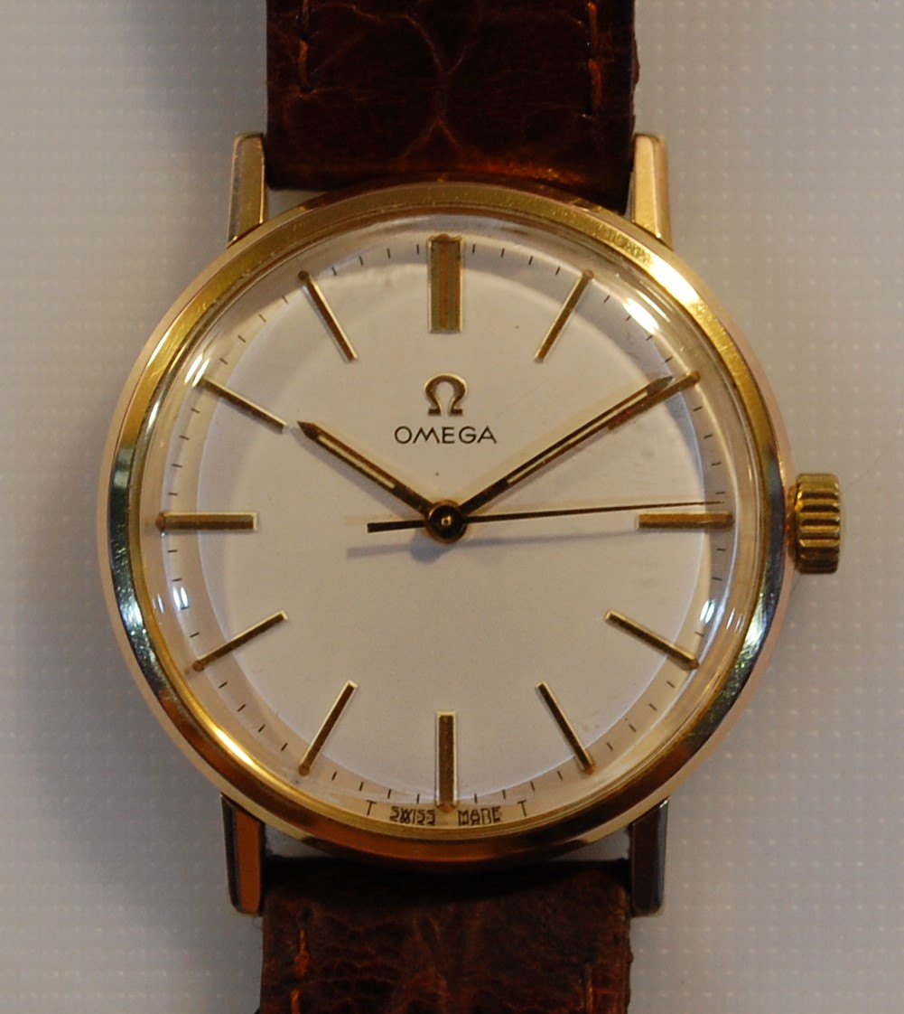 manual date cased gwo omega wristwatch a wind gold geneve aperture pin watches