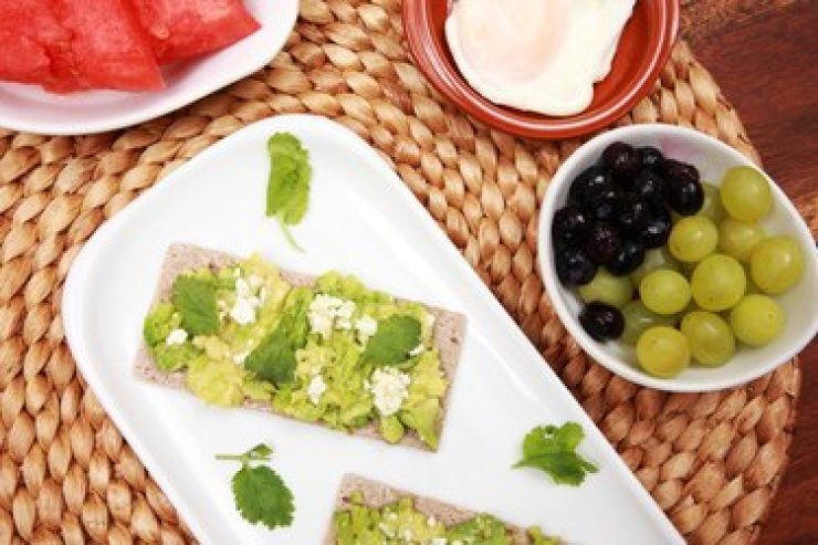 Grapes and guacamole on the table