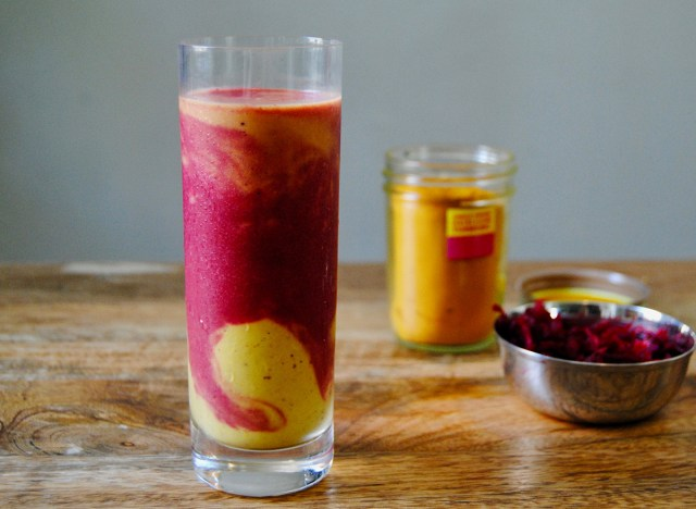 Paleo fruit smoothie in a glass on wooden surface