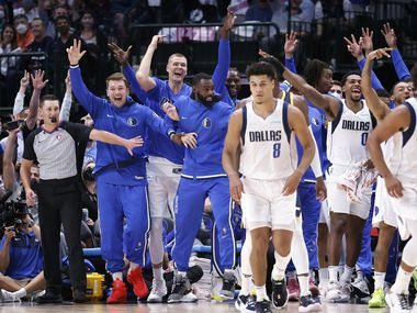 (from left) The Dallas Mavericks Bank, including (from left) guard Luka Doncic, center Kristaps Porzingis and striker Tim Hardaway Jr. celebrate after center Boban Marjanovic hit a three in the second half against Utah Jazz at the American Airlines Center in Dallas Has.  Wednesday, October 6, 2021. The Mavericks defeated Jazz, 111-101.