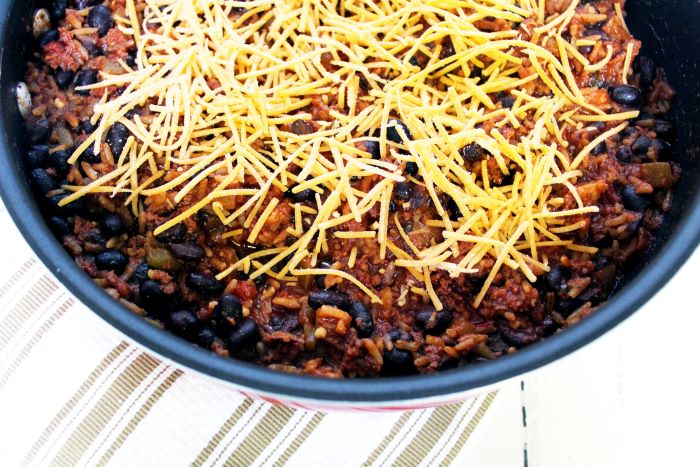 spanish rice and chorizo skillet with cheese close up