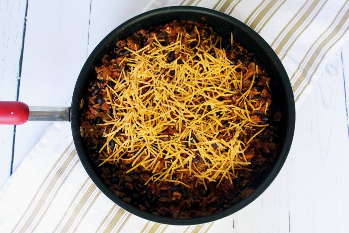 spanish rice and chorizo skillet with cheese top view