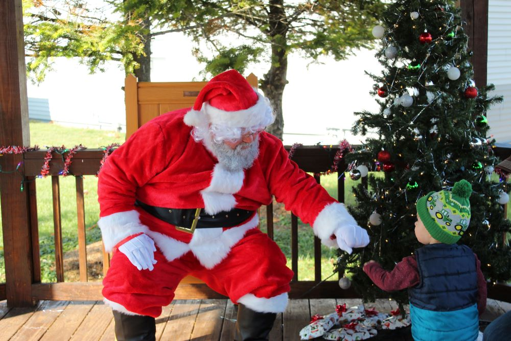 Camden giving santa a fistbump not sitting on Santa's lap