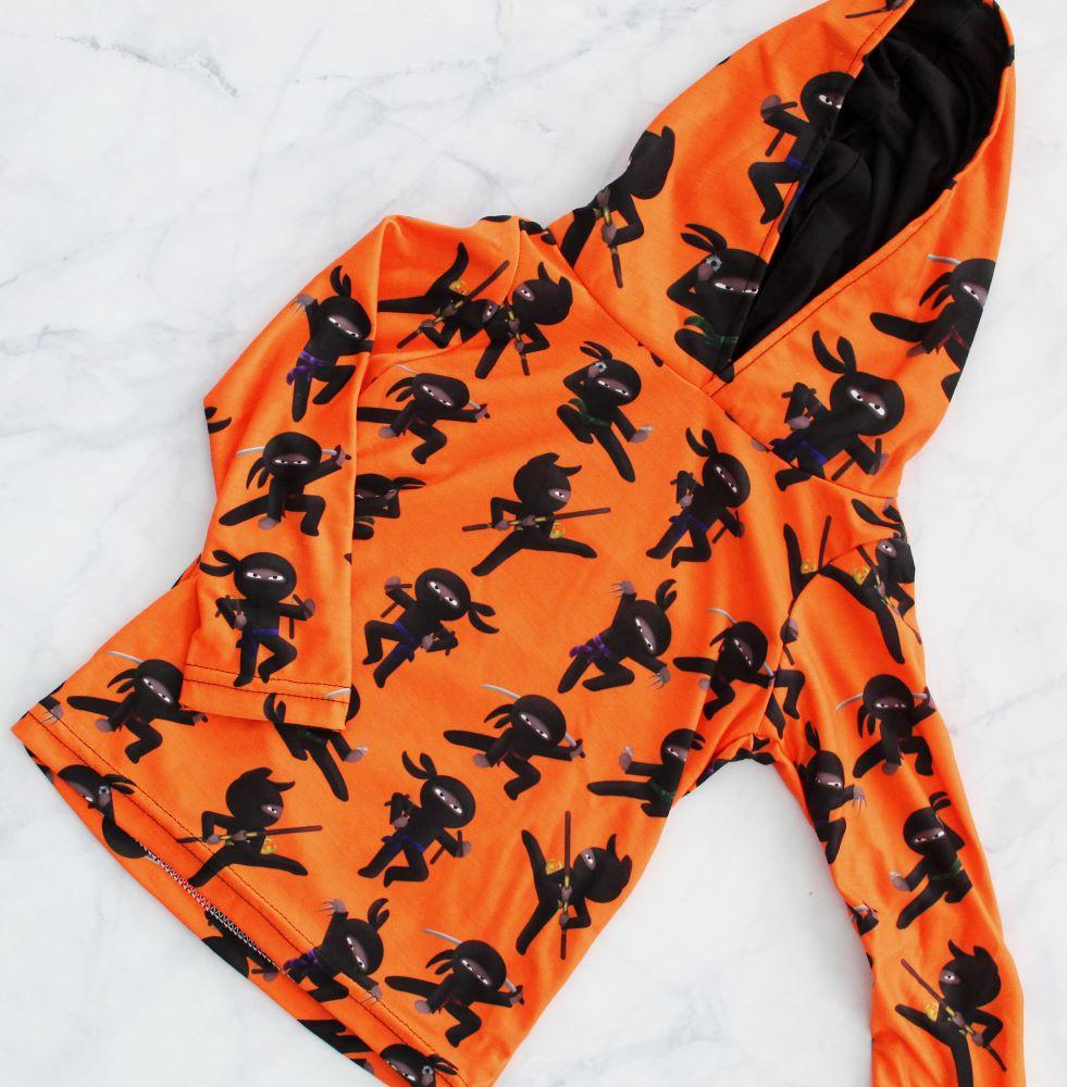 ninja pullover tiny human clothing flatlay 1