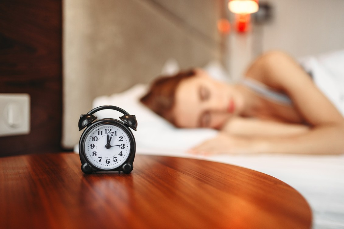 stay at home morning routine woman sleeping with alarm clock