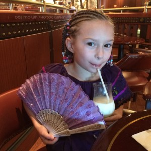Hanging out in the Explorers Lounge. The Girl loved her fan and dress from Costa Maya. Purple, of course. Oh, and she became quite the fan of virgin pina coladas.