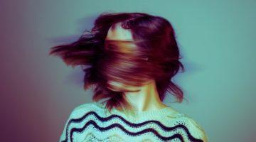 women shaking her hair