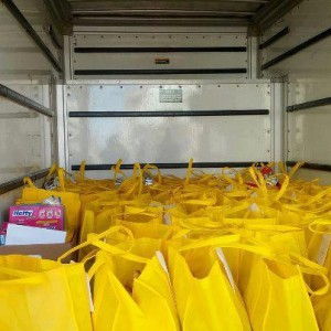 Volunteers load up a truck to deliver food to the less fortunate.