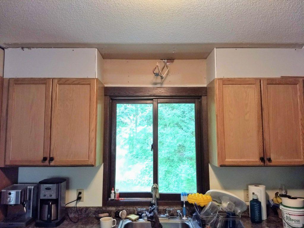 sconce light above the kitchen sink
