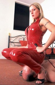 Awesome Blond Domina in Red PVC Dominates a male slave