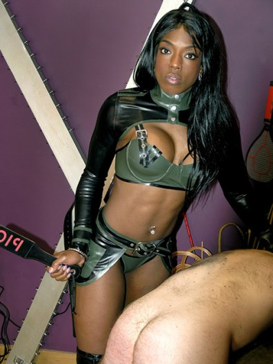 Beautiful Black Mistress Tramples, Paddles and Tortures Her hooded slave