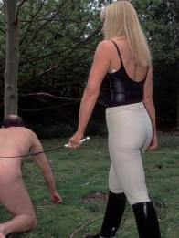 Blond Equestrian Mistress Trains and Whips a naked slave in the Woods