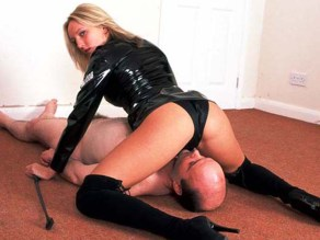Blond Mistress in Latex Facesits a humiliated slave