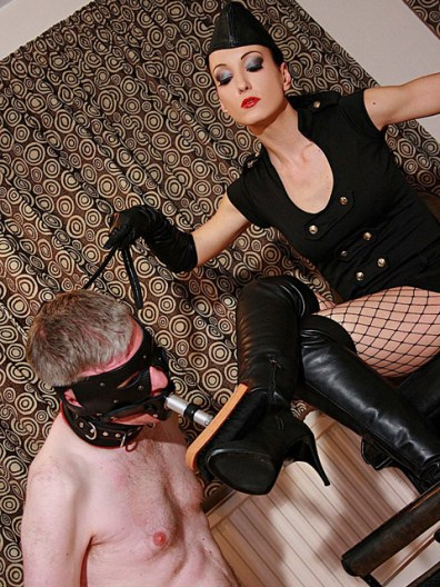 Hot Mistress Liza in Military Outfit Whips and Disciplines a male slave
