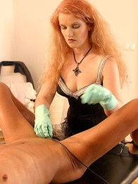 Hot Redhead Domina in Corset Restrains and Tortures a hooded male slave