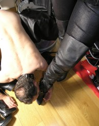 Mature Military Dominatrix in Corset and Thigh High Boots Trains a slave
