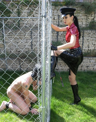 Military Fetish Liza in Latex Trains Her caged and hooded slave Outside