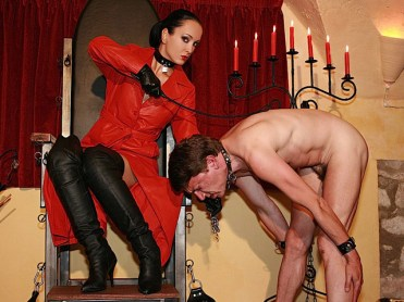 Mistress Liza in Leather Humiliates a naked male slave