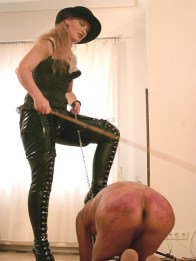 Playful Redhead Domina Whips Her male slave and Dominates him Hard