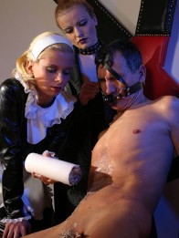 Redhead Domina and Her Maid Torture Their slave with Wooden Pegs and Wax