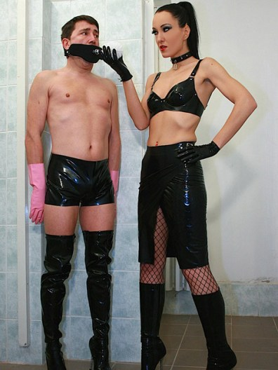 Sexy Liza in PVC Outfit Humiliates and Uses a male slave as Toilet Brush