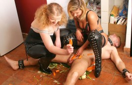 Two Hot Mistresses Degrade and Penetrate a collared slave with Vegetables