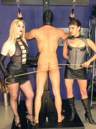 Two Mistresses Spank a slave and Get Their Boots Licked