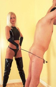 Young Blond Domina in Thigh High PVC Boots Scratches and Whips a slave