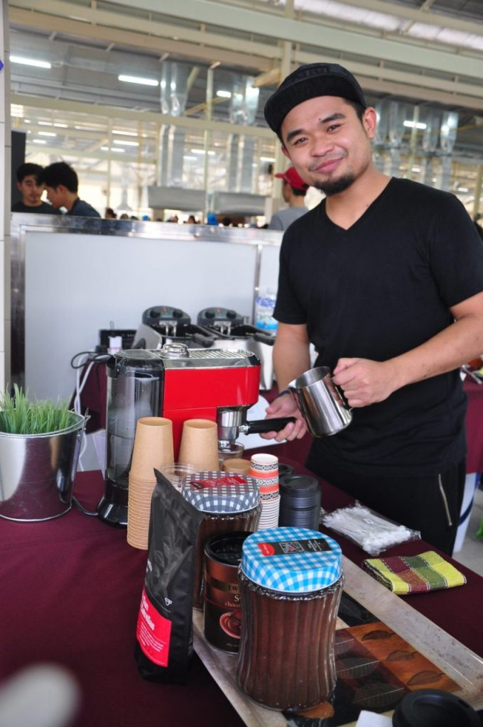 Md Safwan making some coffee at his stall at the Pasar Pelbagai Barangan in Gadong.