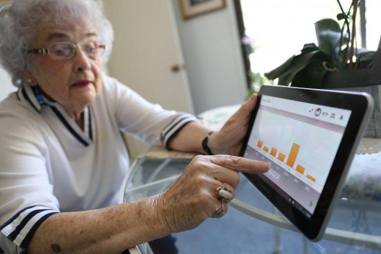 Senior using Tablet PC