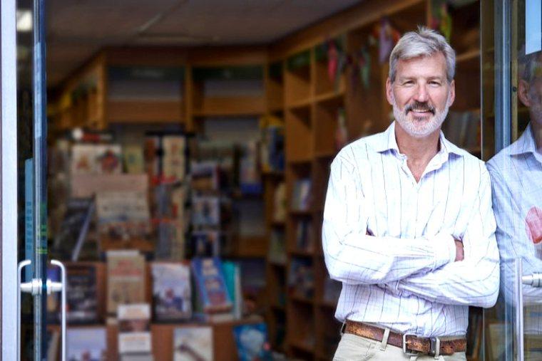 Proud bookshop owner