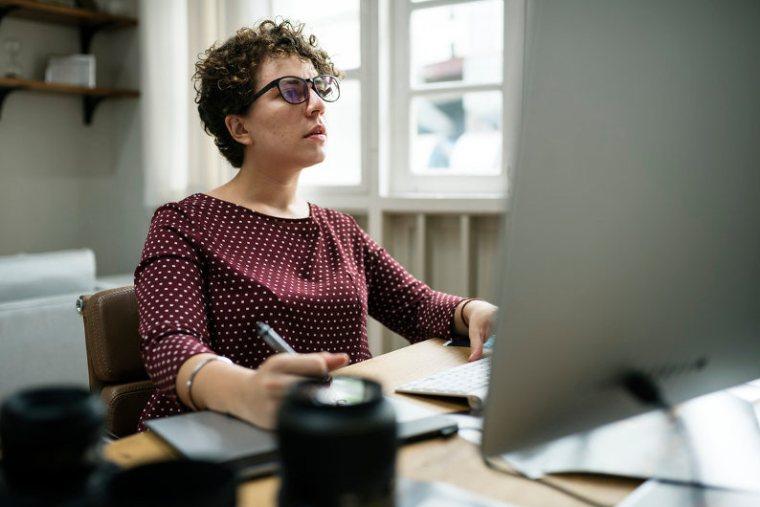 Employees using office tech