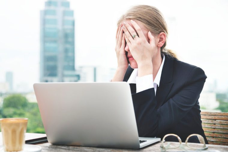 Upset bsuinesswoman experiencing system downtime