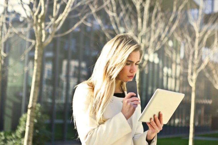 Businesswoman accessing the web using Tablet PC