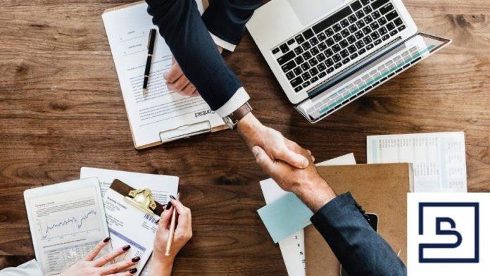 A handshake after closing deals as a freelancer