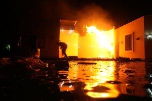 The U.S. Consulate in Benghazi is seen in flames