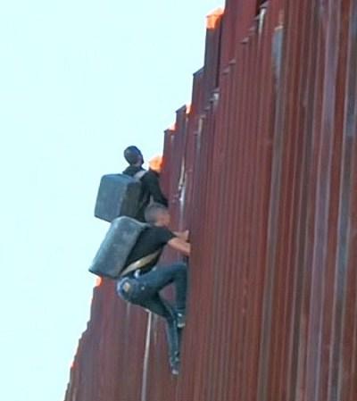 illegals crossing border wall youtube screenshot