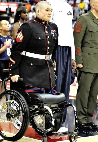 soldier with no legs stands for national anthem