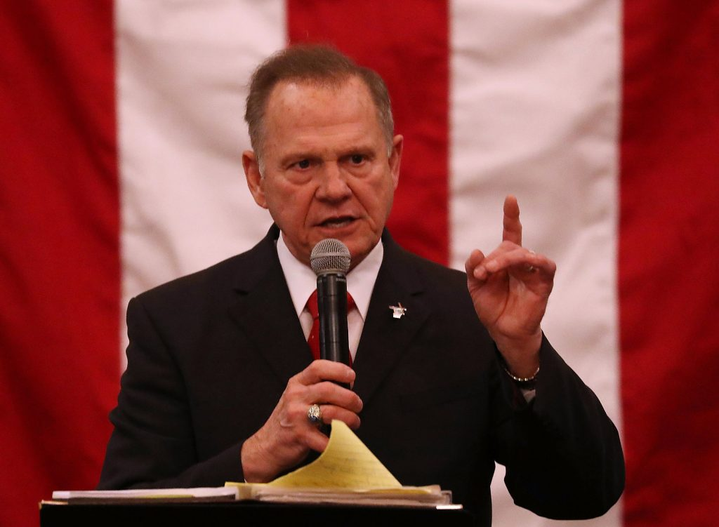 Roy Moore accuser sues him, campaign for defamation
