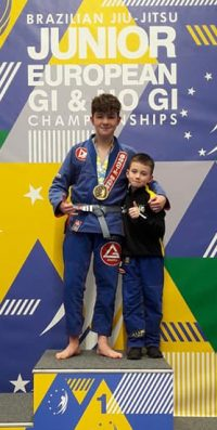 Oscar Dunbar, BJJ School's Junior European Champion, with team mate Kevin McCall