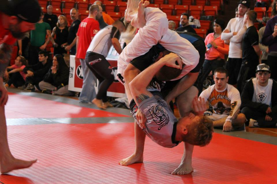 Zach finishing a triangle choke