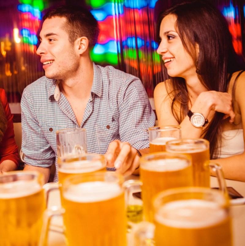 Young couple enjoying drinks at BJ's Bingo