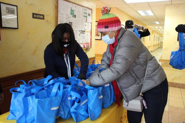 Assemblywoman Tremaine Wright hands out soup at Quincy Senior Residences. Photo: Anna Bradley-Smith.