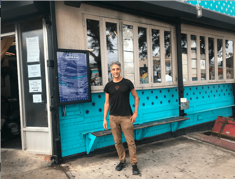 Justin Ahiyon in front of his restaurant, Queen. Photo: Miranda Levingston for The BK Reader.