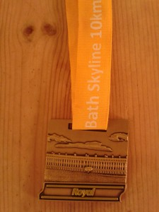 Medal. It came in a plastic bag which is why it's not muddy